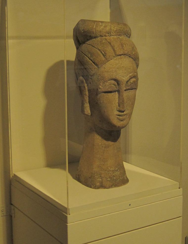 Tête de femme (au chignon) Amedeo Modigliani